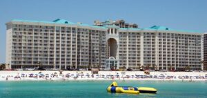 Sitting in a boat on the Gulf of Mexico looking at the Majestic Sun Gulfview condo