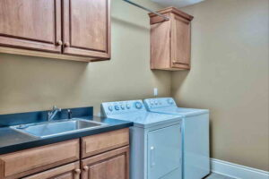 Spacious laundry room in unit 103 at Avalon dunes condo