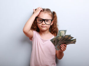 Girl holding money
